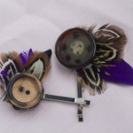 button feather pins